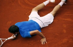 Bulgaria's Grigor Dimitrov falls down as