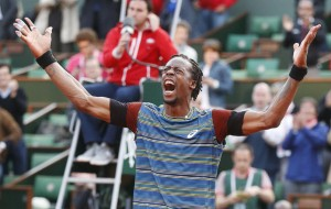 Monfils of France celebrates defeating Berdych of Czech Republic in their men's singles match at the French Open tennis tournament in Paris